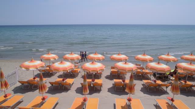 Sunshades on beach at Alassio