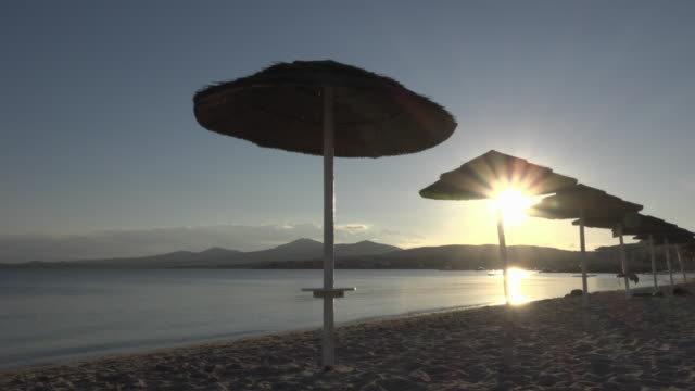 sunshades on beach at sunset - spiaggia stock videos & royalty-free footage