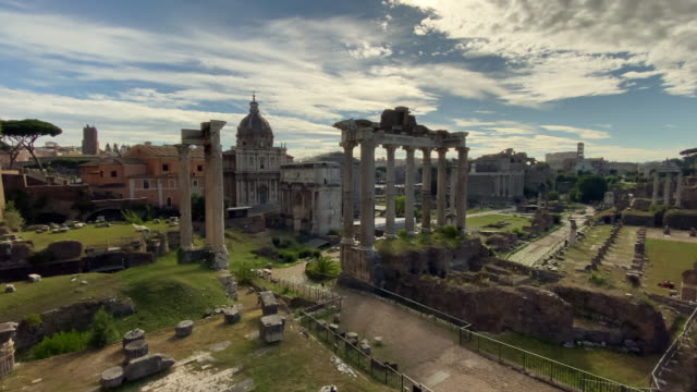 sunshine and clouds hover over the ruins of the recently reopened roman forum in the colosseum archaeological park on june 16 2020 in rome italy... - italian culture stock videos & royalty-free footage