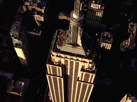 sunshine beautiful color/lighting great generic stock shot of empire state building nyc - new york stato video stock e b–roll