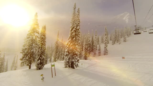 sunshine on ski lift at top of mountain - ski lift stock videos & royalty-free footage