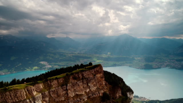 sunshine over lake thun in central switzerland - sunshine lake bildbanksvideor och videomaterial från bakom kulisserna