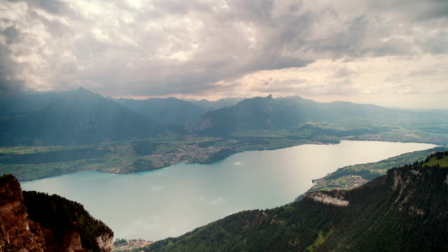 sunshine over lake thun in switzerland - sunshine lake bildbanksvideor och videomaterial från bakom kulisserna