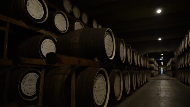 suntory holdings ltd's yamazaki distillery stands in shimamoto osaka japan on friday sept 13 a truck arrives at suntory distillery stills sit at... - distillery still stock videos & royalty-free footage