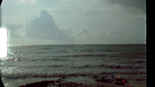 super 8 film clip of the beach and coastline at a luxury resort in the caribbean - film rörlig bild bildbanksvideor och videomaterial från bakom kulisserna