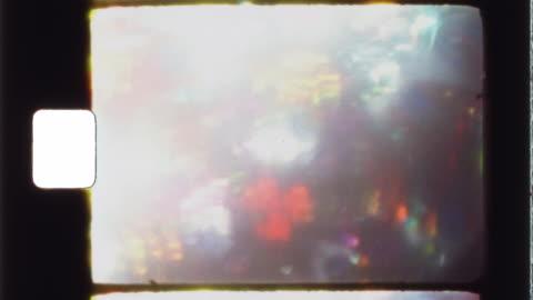vídeos y material grabado en eventos de stock de super 8 film frame with kaleidoscope - authentic vintage film stock - anticuado