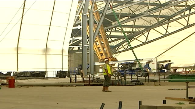 inquiry panel opens worker wearing hard hat on 02 millennium dome construction site - casino worker stock videos and b-roll footage