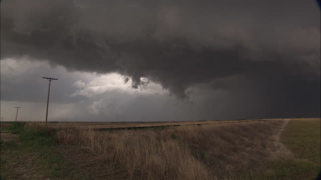 super cell clouds form on a dark horizon. - kansas stock videos & royalty-free footage