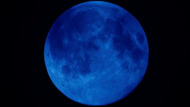 Super full moon moving down night sky HD Video
