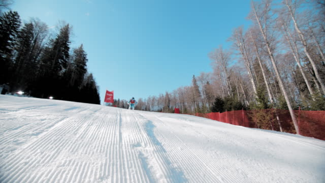 slo mo super giant slalom jump - ski slope stock videos & royalty-free footage