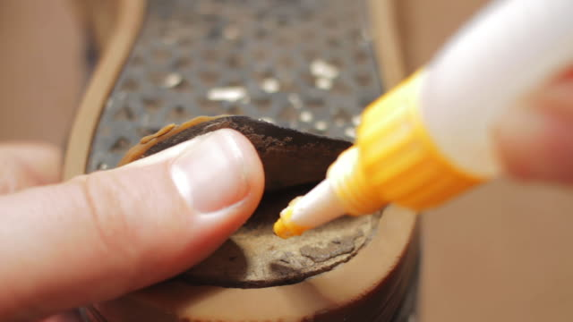 super glue shoe repair - glue stock videos and b-roll footage