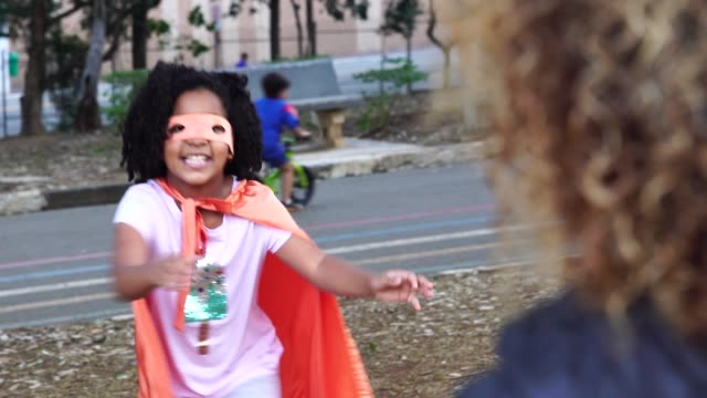 super hero daughter embracing her mother - superwoman stock videos and b-roll footage
