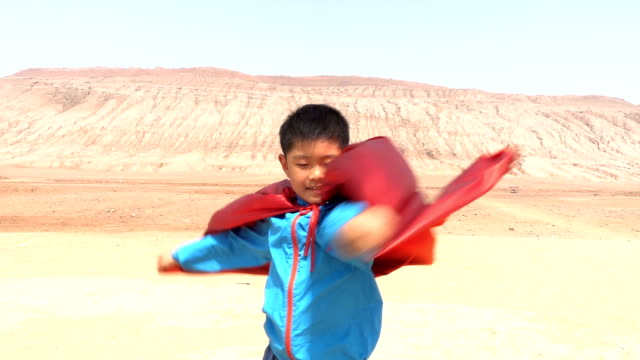 super hero playing in flaming mountain, turpan - cape stock videos & royalty-free footage