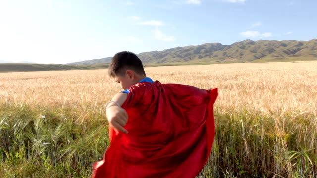 super hero spinning beside wheat fields - heroes stock videos & royalty-free footage