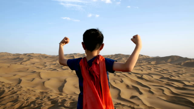 super hero standing in desert - concepts & topics stock videos & royalty-free footage