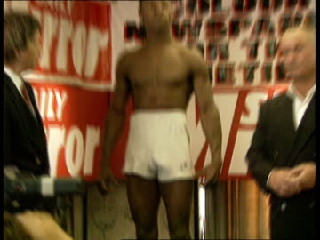 super middleweight title; england london park lane grosvenor hse hotel cms feet in white socks on scales tilt up and pull out chris eubank on scales... - chris eubank sr. stock videos & royalty-free footage