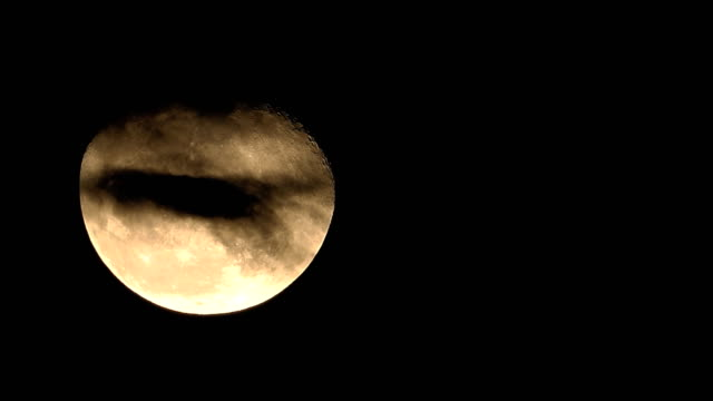 4k: super moon rising and cloud moving - supermoon stock videos & royalty-free footage