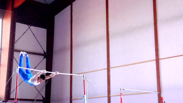 hd: super slo-mo gymnast performing routine on horizontal bar - horizontal bar stock videos and b-roll footage