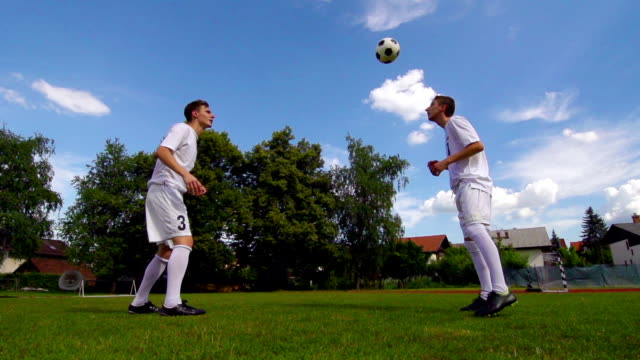 hd: super slo-mo shot of men practicing soccer - only young men stock videos & royalty-free footage