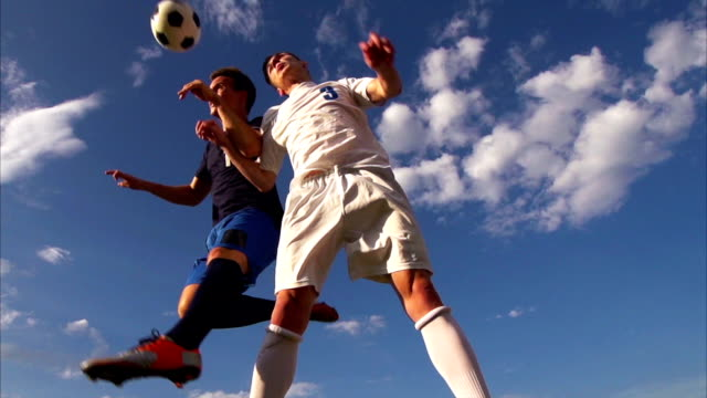 hd: super slo-mo shot of soccer header - human head stock videos & royalty-free footage