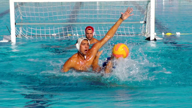 hd: super slo-mo shot of water polo scoring action - headshot stock videos & royalty-free footage