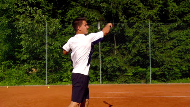 hd: super slo-mo shot of young man playing forehand - forehand stock videos & royalty-free footage
