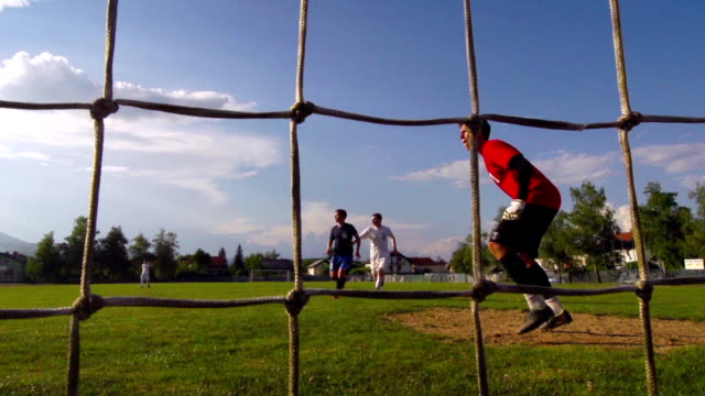 hd: super slo-mo shot of young soccer players - goal - soccer glove stock videos and b-roll footage