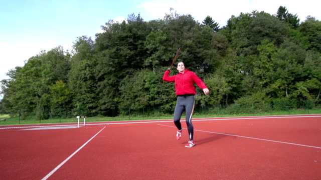 hd: super slo-mo shot of young woman throwing javelin - javelin stock videos & royalty-free footage