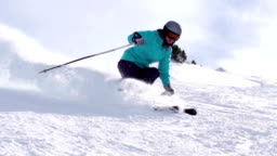 HD: Super Slo-Mo Shot of Young Women Skiing