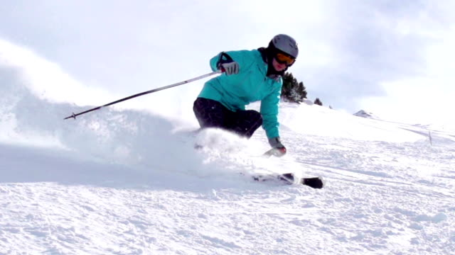 hd: super slo-mo shot of young women skiing - winter sport stock videos and b-roll footage