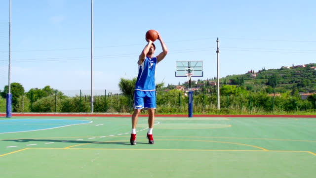 HD: Super Slo-Mo Video of Young Man Practicing Jump Shot
