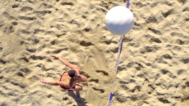 HD Super Slo-Mo:Shot of Young Man Playing Beach Volley