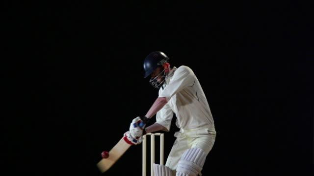 Super Slow Motion - Cricket Batsman cuts the ball - Cover drive