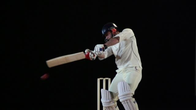 super slow motion, cricket batsman hits the ball - cut shot - drive ball sports stock videos and b-roll footage