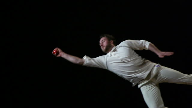 super slow motion -  cricketer takes diving one handed catch - catching stock videos and b-roll footage