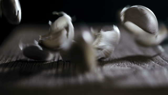 super slow motion : garlic on rustic wood - imperfection stock videos & royalty-free footage