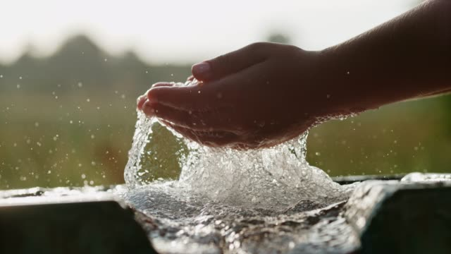 cu super slow motion hands cupping fresh,bubbling water - environmental conservation stock videos & royalty-free footage