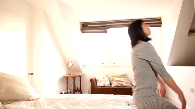 Super Slow Motion HD - Falling backwards onto bed
