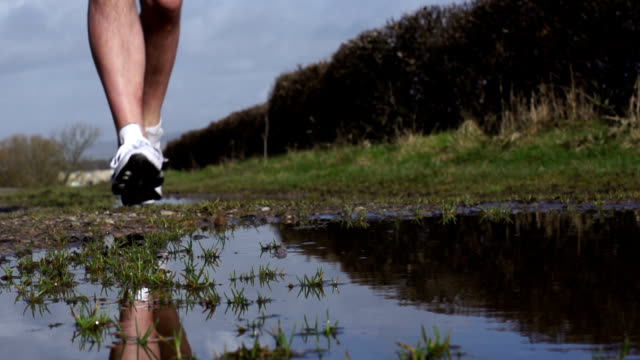 Super Slow Motion HD - Jogging with puddle splash