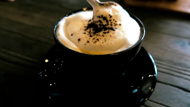 super slow motion hd: mixing coffee - frothy drink stock videos & royalty-free footage