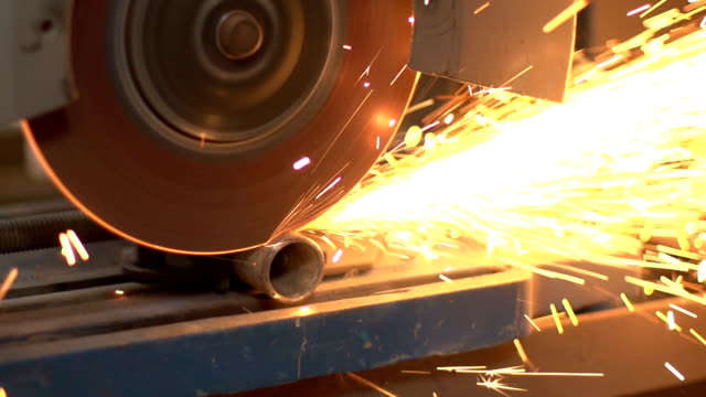 super slow motion hd - sparks flying off cutting saw - metal clip stock videos and b-roll footage