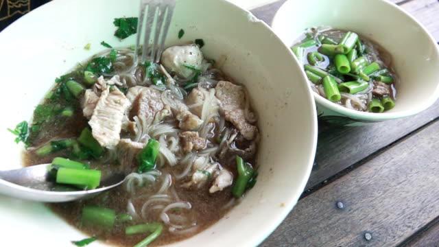 super slow motion hd:thai noodle soup - shiitake stock videos & royalty-free footage
