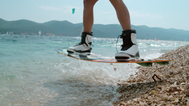 ms super slow motion kiteboarder catching air,taking off over sunny ocean,peljesac,croatia - exhilaration stock videos & royalty-free footage