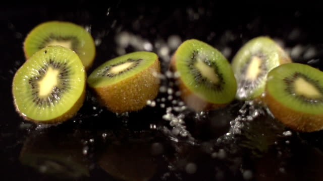 super slow motion: kiwi fruit falling - kiwi fruit stock videos and b-roll footage