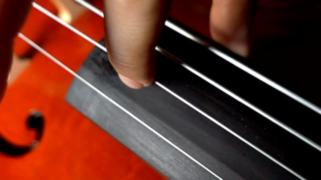super slow motion of cello string - string stock videos & royalty-free footage