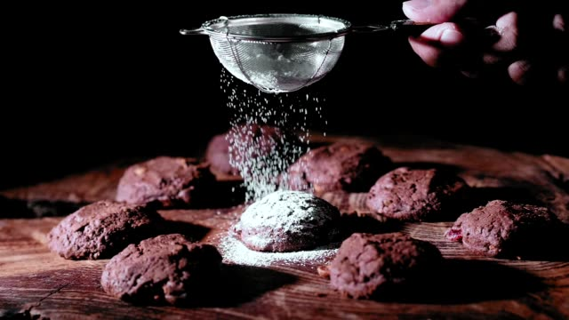 super slow motion of cookie with sugar - chocolate chip cookie stock videos and b-roll footage