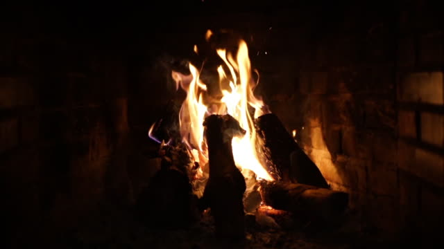 Super slow motion of fireplace with fire