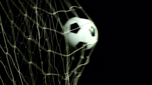 super slow motion, soccer ball scoring goal (football net) - scoring a goal stock videos and b-roll footage
