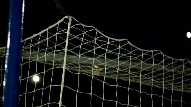 super slow motion, soccer / football goal in top cormer - netting stock videos and b-roll footage
