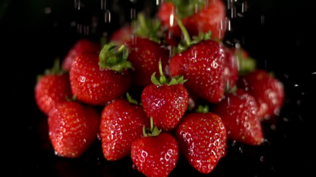 Super Slow Motion: Strawberries sprinkled with water